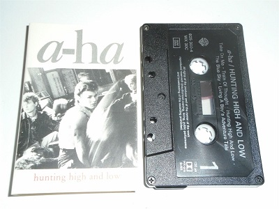 A-HA - Hunting High and Low Cassette Tape Black Shell Silver Text 075992530040
