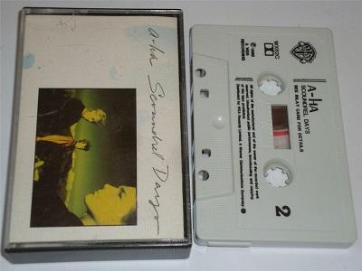 A-HA - Scoundrel Days Cassette Tape Aha White shell Black text WX62C